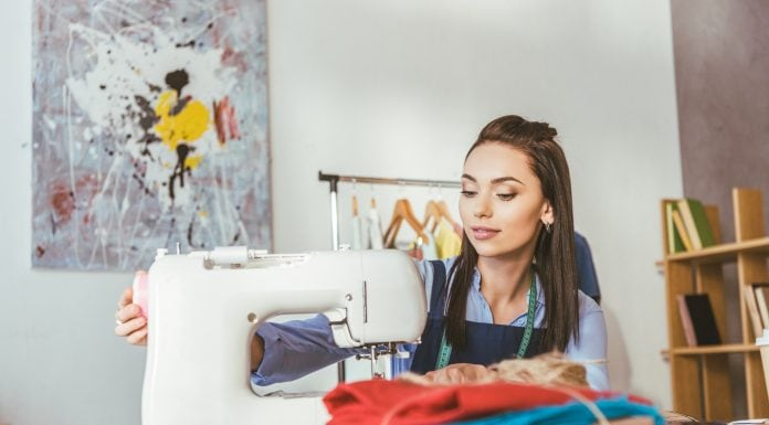woman learning to sew on her machine