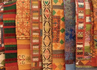 tapestries arranged in a line