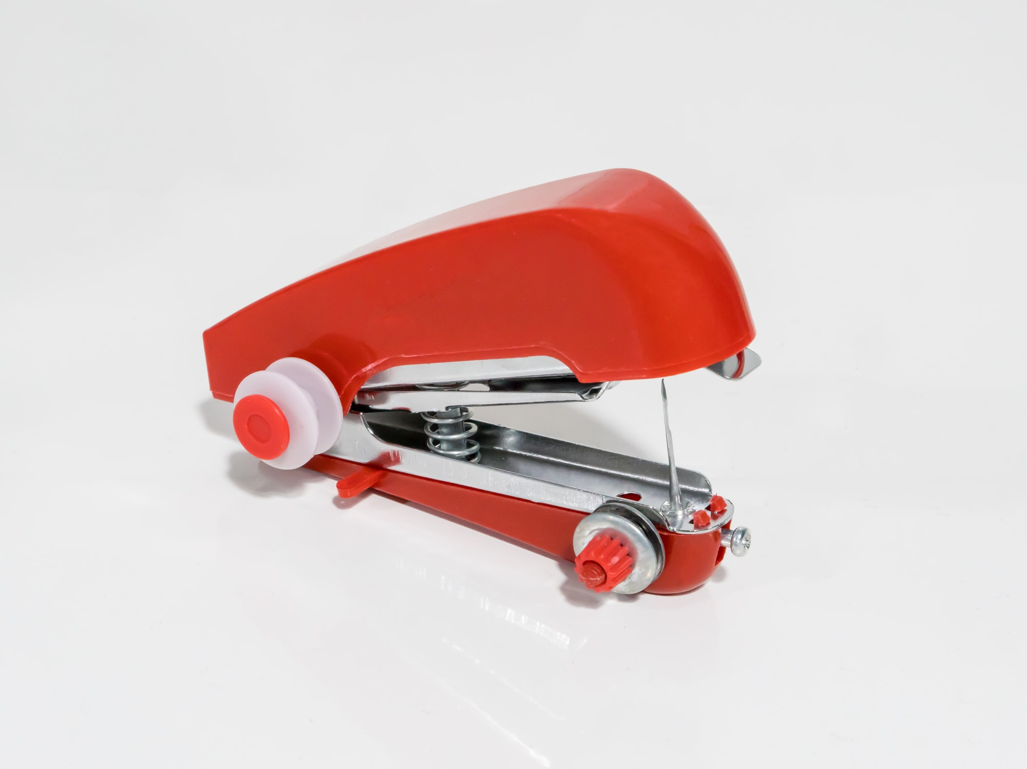Red handheld sewing machine