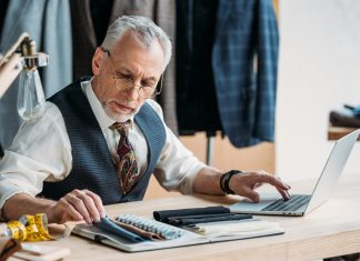 tailor downloading embroidery software on his laptop