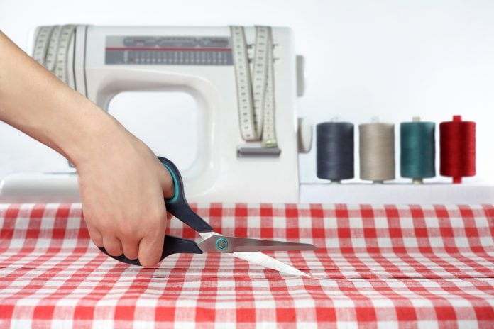 fabric cutting scissors in front of a sewing machine