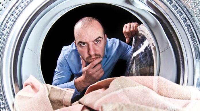 man thinking about washing symbols and their compatibility with the machine