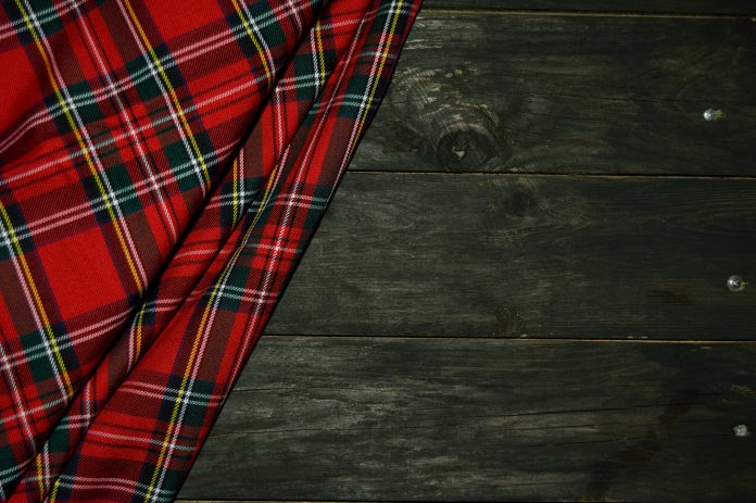 tartan for kilt on a wooden background