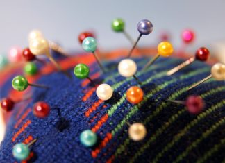 Colorful needle bed with sewing pins