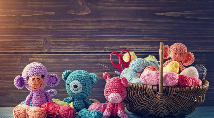 Amigurumi toy animals next to a basket