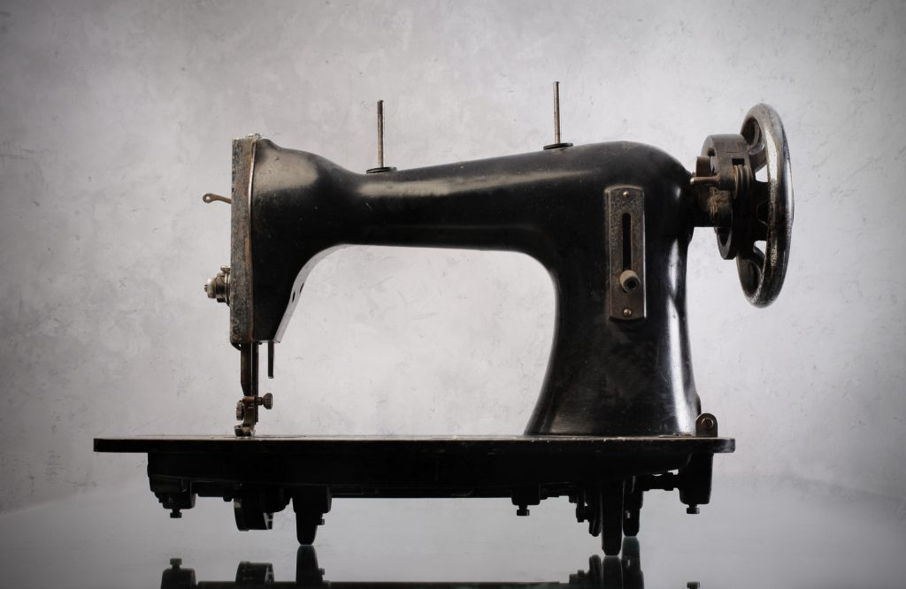 black vintage sewing machine on a white background