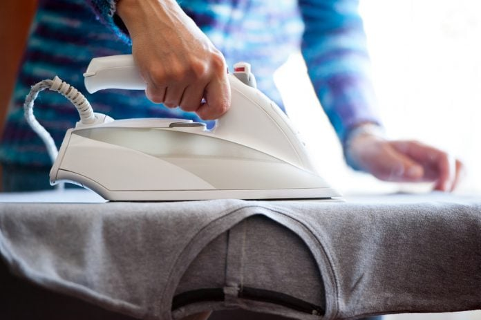lady ironing clothes with her iron