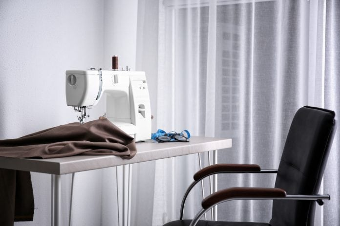 chair next to a sewing machine